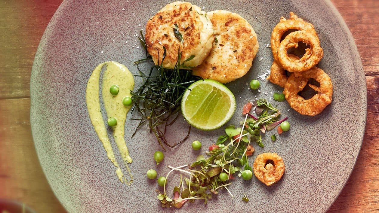 - Fish Cakes with a Micro Herb Salad served with Onion Bhajas and Pea Cream